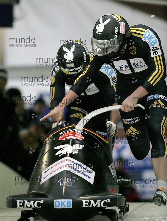 (November 21, 2009) Karl Angerer (front) and Gregor Bermbach of Germany  push in the first run en route to a 8th place finish at  the Federation Internationale de Bobsleigh et de Togogganing (FIBT) two-man men's bobsled World Cup race at the Olympic Sports Complex in Lake Placid, New York.