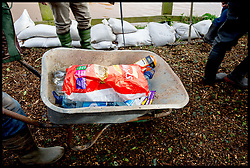 Burrowbridge, Somerset, United Kingdom.Sunday, 9th February 2014.  Emergency food supplies on it's way  to residents affected by the somerset Levels floods. The Somerset Levels  has been flooded since the start of 2014, with people being forced to leave their homes. Picture by Andrew Parsons / i-Images