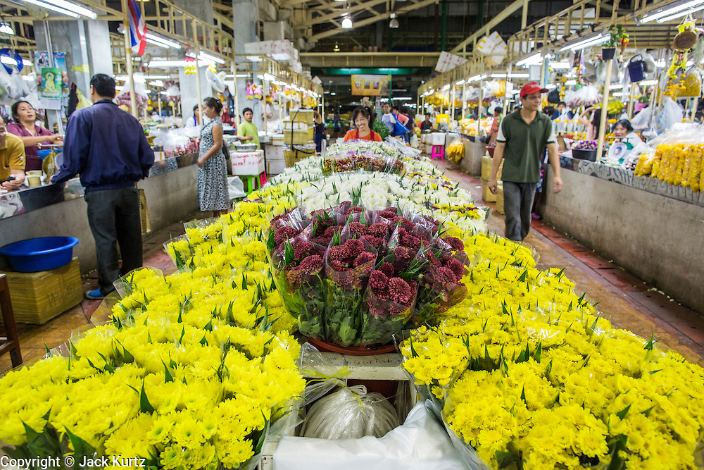 19 OCTOBER 2012 - BANGKOK, THAILAND:   The main aisle in the Bangkok Flower Market. The Bangkok Flower Market (Pak Klong Talad) is the biggest wholesale and retail fresh flower market in Bangkok.  The market is busiest between 3:30AM and 6AM. Thais grow and use a lot of flowers. Some, like marigolds and lotus, are used for religious purposes. Others are purely ornamental.        PHOTO BY JACK KURTZ