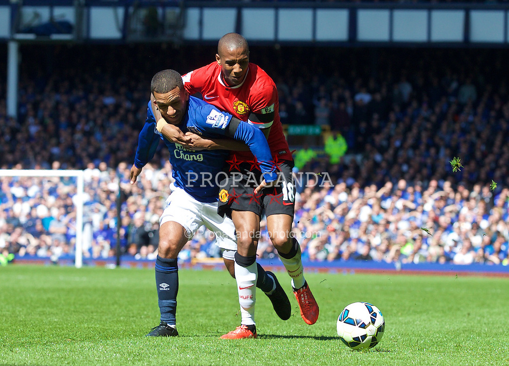 LIVERPOOL, ENGLAND - Sunday, April 26, 2015: Everton's Aaron Lennon is fouled by Manchester United's Ashley Young during the Premier League match at Goodison Park. (Pic by David Rawcliffe/Propaganda)
