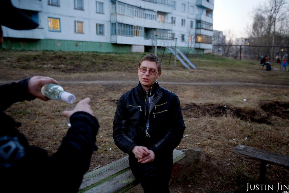 Youngsters smoke and drink vodka in the town of Ivanovo