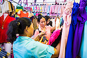 06 JUNE 2013 - BANGKOK, THAILAND:     People shop for clothes in Bobae Market in Bangkok. Bobae Market is a 30 year old market famous for fashion wholesale and is now very popular with exporters from around the world. Bobae Tower is next to the market and  advertises itself as having 1,300 stalls under one roof and claims to be the largest garment wholesale center in Thailand.       PHOTO BY JACK KURTZ