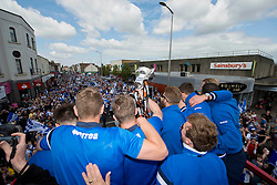 Bristol Rovers' players show off the Vanarama conference play-off semi-final trophy to fans - Photo mandatory by-line: Dougie Allward/JMP - Mobile: 07966 386802 - 25/05/2015 - SPORT - Football - Bristol - Bristol Rovers Bus Tour