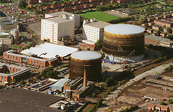 Aerial view of gas holders next to the Robin Hood Line in Radford; Nottingham, The large white buildings are John Players bonded warehouse,