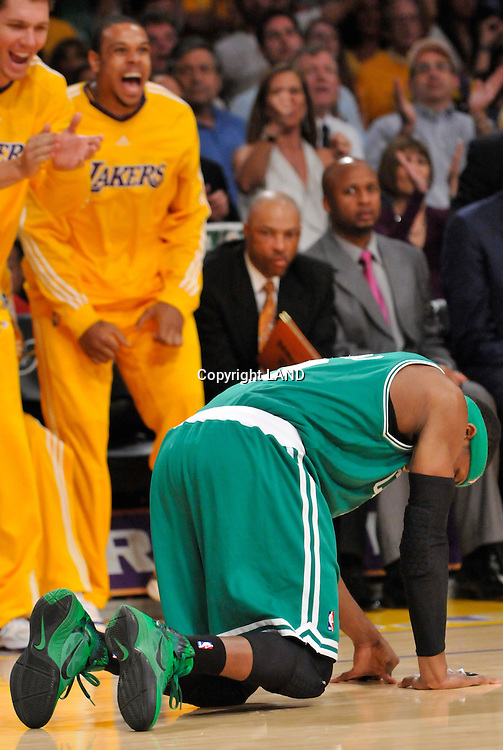 Rajon Rondo is on the floor in the 4th quarter while the Laker bench errupts. The Lakers defeated the Boston Celtics in game 7 of the NBA Finals  83-79 in Los Angeles, CA 06/16/2010 (John McCoy/Staff Photographer).
