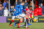 Ryan Jack knocks the ball past Mikel Miller looking to connect with a team mate during the Ladbrokes Scottish Premiership match between Hamilton Academical FC and Rangers at The Hope CBD Stadium, Hamilton, Scotland on 24 February 2019.
