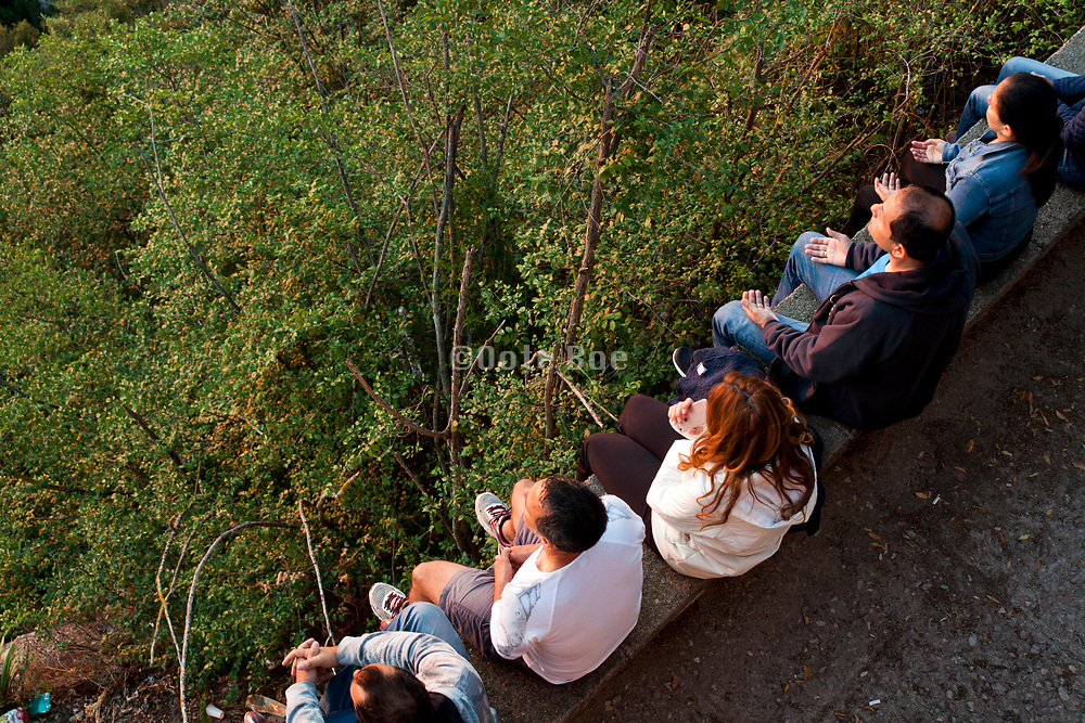 group meditating while watching the sunrise at Montserrat Spain