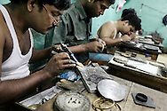 Workers assemble gold accessaries at gold workshop run by Abhijit Bank and his brother Sujit in Mumbai, India on Dec 8, 2010.<br /> (Photo by Kuni Takahashi)