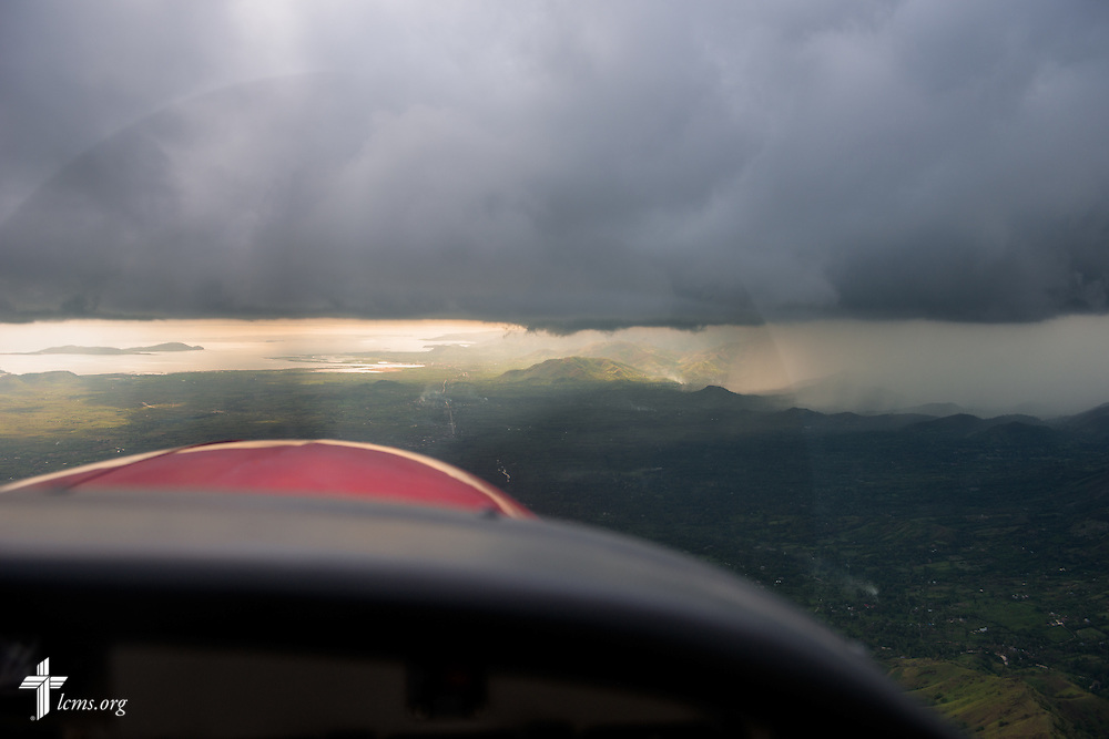 A storm loom over the region in Haiti near Les Cayes on Tuesday, Oct. 11, 2016, seen through a light aircraft.  LCMS Communications/Erik M. Lunsford