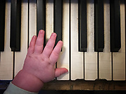 Baby Hand on Piano-Misoc Lessons