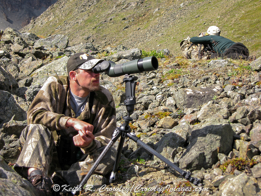 Hunters use spotting scopes to scout for Dall Sheep in the Chugach Mountains of Alaska