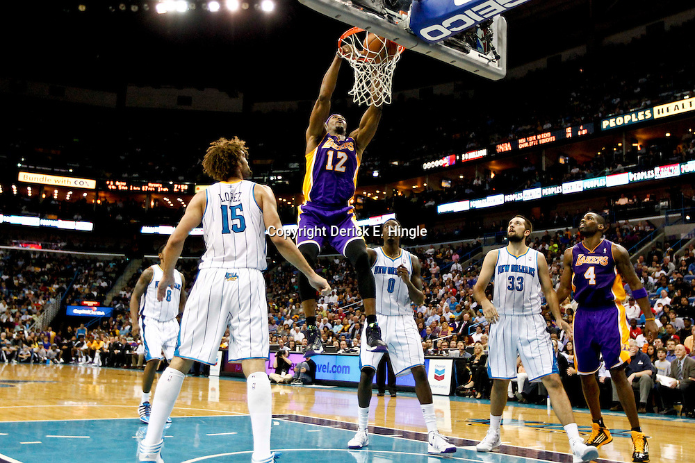 Dec 5, 2012; New Orleans, LA, USA; Los Angeles Lakers center Dwight Howard (12) dunks over New Orleans Hornets center Robin Lopez (15) and small forward Al-Farouq Aminu (0) and power forward Ryan Anderson (33) during the second quarter of a game at the New Orleans Arena. The Lakers defeated the Hornets 103-87.  Mandatory Credit: Derick E. Hingle-USA TODAY Sports