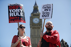 June 10, 2017 - London, UK - People protest against Prime Minister Theresa May's new government and a coalition with the DUP in Parliament Square, London as the UK snap general election leads to a hung parliament. (Credit Image: © Tolga Akmen/London News Pictures via ZUMA Wire)