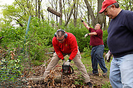 (from left) Boy Scout Troop 193 Scoutmaster Jim Cunningham, Eric Bowser and Chuck Rouhier during a cleanup of the Victory Oak Knoll Memorial near the entrance of Dayton's Community Golf Course (at the edge of Kettering,) Saturday, May 7, 2011.