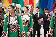 Young women in Turkmen costumes perform traditional dances outside the City Hippodrome in Ashgabat on the occasion of the National Turkmen Horse Day