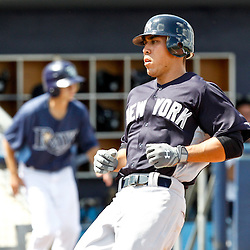 March 21, 2012; Port Charlotte, FL, USA; New York Yankees base runner Justin Maxwell scores on a Raul Ibanez ground out during the top of the sixth inning of a spring training game against the Tampa Bay Rays at Charlotte Sports Park.  Mandatory Credit: Derick E. Hingle-US PRESSWIRE