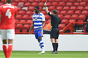 Referee Geoff Eltringham shows a yellow card to Reading defender Tyler Blackett (24) during the EFL Sky Bet Championship match between Nottingham Forest and Reading at the City Ground, Nottingham, England on 22 April 2017. Photo by Jon Hobley.
