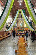 Worshippers visit the Janitzio Church decorated for the Day of the Dead festival on Janitzio Island, Michoacan, Mexico.