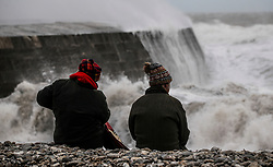 © Licensed to London News Pictures. 03/03/2019. Lyme Regis, UK. Waves crash up on to the shore at Lyme Regis in Dorset during the full force of storm Freya as winds and rain hit the coast. Photo credit: Jason Bryant/LNP