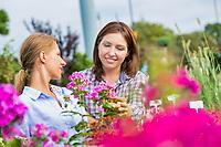 Women looking at flower in shop