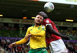 Tom Trybull of Norwich City battles with Famara Diedhiou of Bristol City for the ball - Mandatory by-line: Robbie Stephenson/JMP - 23/09/2017 - FOOTBALL - Carrow Road - Norwich, England - Norwich City v Bristol City - Sky Bet Championship