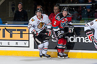 KELOWNA, CANADA - OCTOBER 4:  Oliver Bjorkstrand #22 of the Portland Winterhawks checks Jesse Lees #2 of the Kelowna Rockets  at the Kelowna Rockets on October 4, 2013 at Prospera Place in Kelowna, British Columbia, Canada (Photo by Marissa Baecker/Shoot the Breeze) *** Local Caption ***