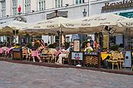 Tallinn, Estonia -- July 23, 2019. Photo of people dining at an outdoor restaurant in Tallinn, Estonia.
