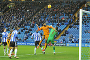 Wolverhampton Wanderers defender Ethan Ebanks-Landell attempts header into goal cleared by Keiren Westwood of Sheffield Wednesday during the Sky Bet Championship match between Sheffield Wednesday and Wolverhampton Wanderers at Hillsborough, Sheffield, England on 20 December 2015. Photo by Ian Lyall.