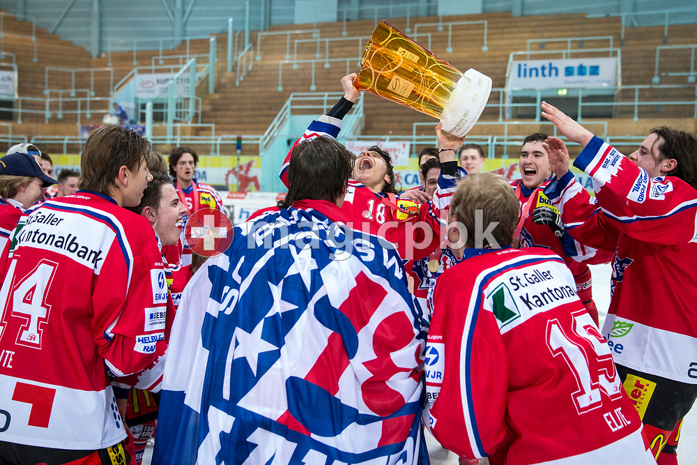 Rapperswil-Jona Lakers forward Toni Szabo holding the Swiss champion trophy and his teammates celebrate after winning the fifth Elite B Playoff Final ice hockey game between Rapperswil-Jona Lakers and ZSC Lions held at the SGKB Arena in Rapperswil, Switzerland, Sunday, Mar. 19, 2017. (Photo by Patrick B. Kraemer / MAGICPBK)