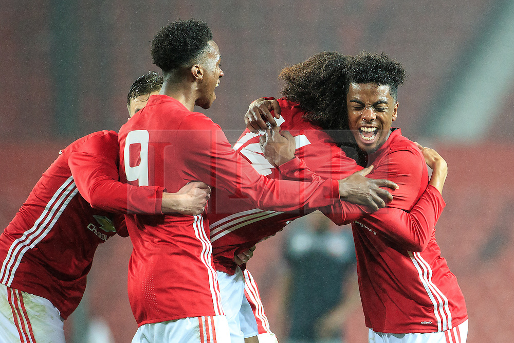 © Licensed to London News Pictures . 12/12/2016 . Manchester , UK . Celebrating substitute TAHITH CHONG putting MUFC 1 goal up . Manchester United vs Southampton FA Youth Cup Third Round match at Old Trafford . Photo credit : Joel Goodman/LNP