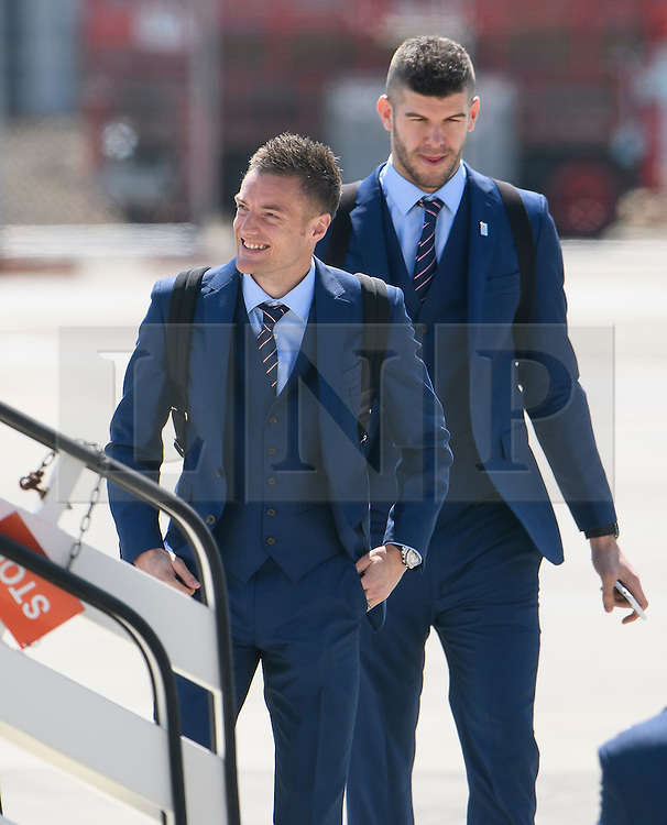 © Licensed to London News Pictures. 06/06/2016. Luton, UK. JAMIE VARDY And FRAZER FOSTER join other members of England national football squad as they board a plane at Luton airport in Befordshire, England, to head for their traning camp in France, ahead of the start of the UEFA Euro 2016 championships.  Photo credit: Ben Cawthra/LNP