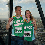 London, England, UK. Actor Christopher Harper and wife Emily Bowker participate The Gherkin Challenge at the The Gherkin rise fund for NSPCC help children across the UK to rebuild their lives.