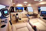 """How's that for a way to travel: Luxury limousine comes fitted out with drinks cabinet, computer system and even an exercise bike<br /> <br /> For most of us, taking a trip in the car means missing out on certain luxuries which we enjoy at home.<br /> However, for anyone wealthy enough to own this luxury limousine, that needs not be the case.<br /> The opulent vehicle comes fitted out with a number of incredible features, including a built-in exercise bike which can be used whilst sitting back in one of the leather seats.<br /> <br /> The vehicle also comes with a burr wood trimmings drinks cabinet, large screen HD television, surround sound system, wifi and computer system.<br /> There is also the option of armour plating for those high profile oligarchs or even politicians around the world who believe they need the security.<br /> The Cadillac Escalade ESV conversions vehicle has been made by US custom company Becker Automotive Designs.<br /> <br /> The vehicle costs between £83,500 and £161,000 depending on the final specifications.<br /> In advertising the vehicle, the company says: 'Gaining the edge in today's competitive business environment means using every minute of your busy day to its best advantage. <br /> 'The Becker Cadillac Escalade ESV allows you to transform travel time into some of the most tranquil, focused and productive time in your schedule.<br /> <br /> 'Powerfully equipped-with all of the comforts and amenities of the office at your fingertips, for those who appreciate the value of time.<br /> 'Manage correspondence, access the internet and get news and market updates on a full sized display integrated into the cabins Crestron-controlled privacy partition. <br /> 'Make calls and hold conferences when others simply cant. Becker's full mobile office suite allows voice and video communication any time.<br /> 'Conduct meetings in your quiet, spacious """"boardroom"""" and even produce documents on demand.<br /> 'Take the rush out of rush hour. Spend you"""