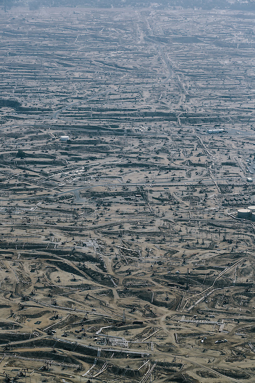 Oil pumps and scarred earth can be seen for miles in an area of North Bakersfield called the Bluffs. The Sycamore Cogeneration Plant sits in the middle of the fields and is one of California's top polluters.