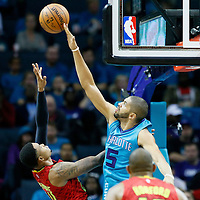01 November 2015: Charlotte Hornets forward Nicolas Batum (5) blocks Atlanta Hawks guard Kent Bazemore (24) during the Atlanta Hawks 94-92 victory over the Charlotte Hornets, at the Time Warner Cable Arena, in Charlotte, North Carolina, USA.