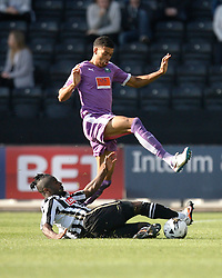 Stanley Aborah of Notts County tackles Jake Jervis of Plymouth Argyle (Top) - Mandatory byline: Jack Phillips / JMP - 07966386802 - 11/10/2015 - FOOTBALL - Meadow Lane - Nottingham, Nottinghamshire - Notts County v Plymouth Argyle - Sky Bet Championship