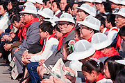 Chinese Communist Party General Secretary Jiang Zemin, center, with Premier Li Peng, right, during International Childrens Day celebrations held in Tiananmen Square June 2, 1990 in Beijing, China. The event was held as a distraction from the anniversary of the massacre that killed student-led democracy protesters in 1989.
