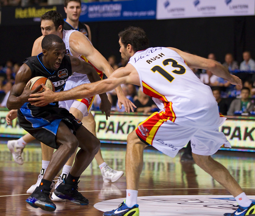 Breakers' Cedric Jackson  is challenged by Tigers' Liam Rush in an ANBL Basketball Match, North Shore Events Centre, Auckland, New Zealand, Thursday, January 19, 2012.  Credit:SNPA / David Rowland