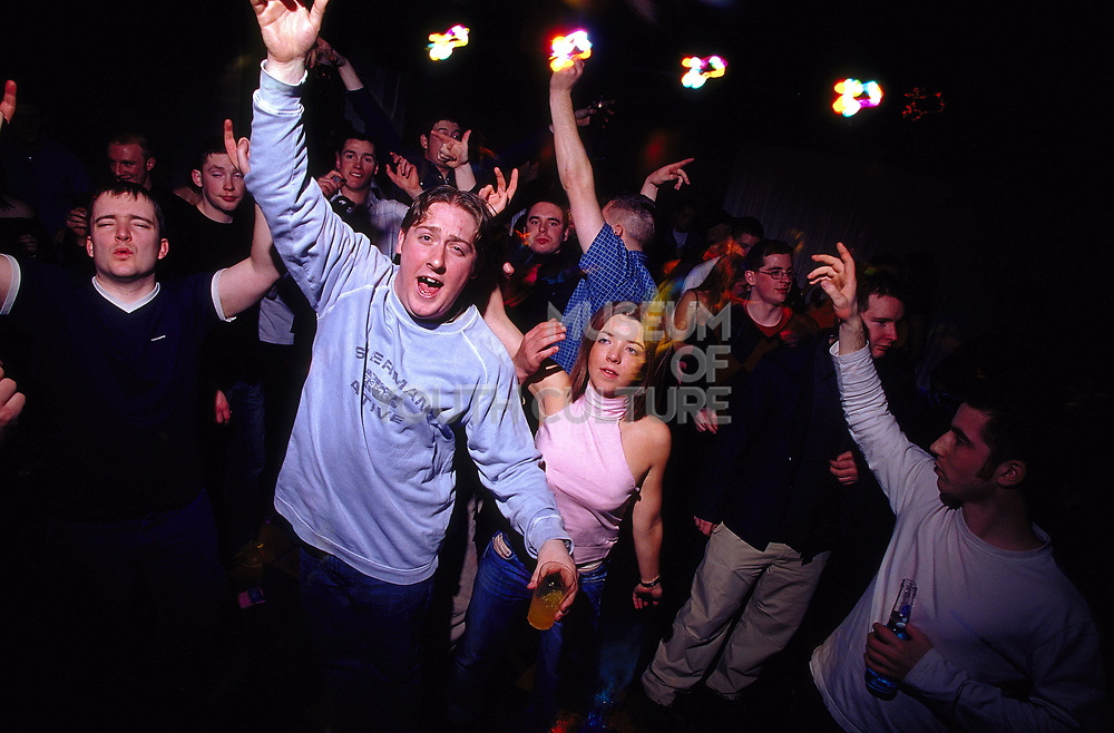 Young clubbers dancing at Inertia Derry Northern Ireland March 2002