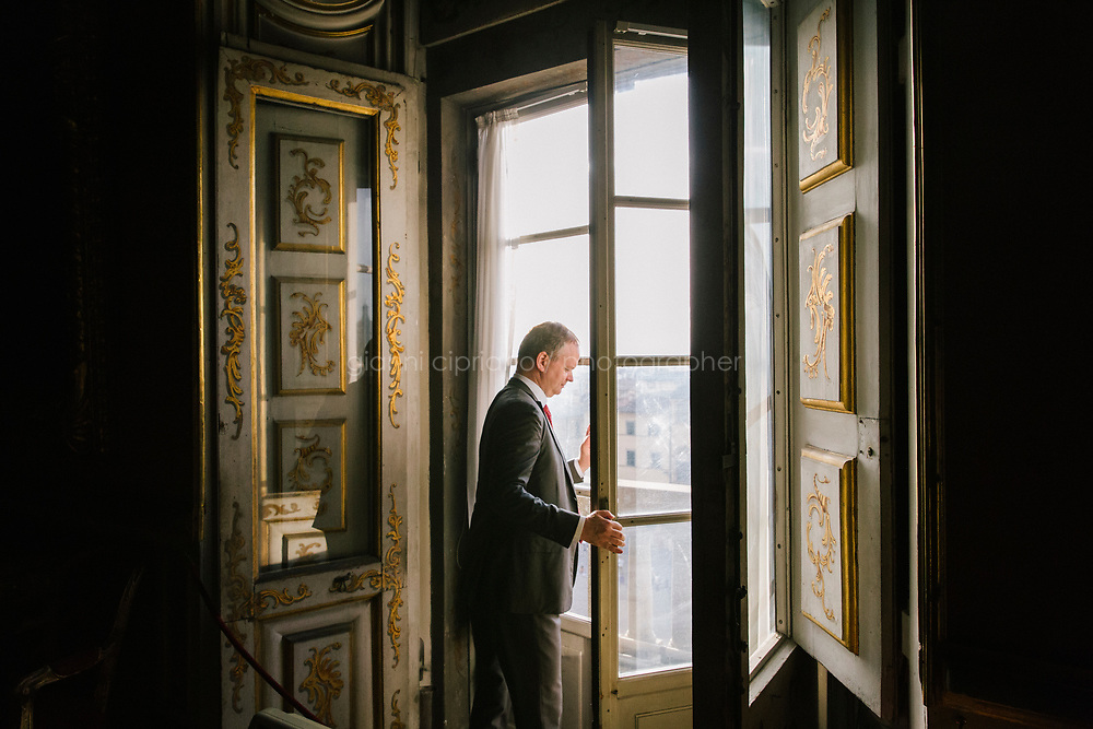 FLORENCE, ITALY - 3 JUNE 2018: Uffizi Director Eike Schmidt is seen here at Palazzo Pitti before overseeing the transportation of dual portraits of Agnolo Doni and his wife Maddalena Strozzi, painted by Raphael, to their new location at room 41 of the Uffizi, in Florence, Italy, on June 3rd 2018.<br /> <br /> As of Monday June 4th 2018, Room 41 or the &ldquo;Raphael and Michelangelo room&rdquo; of the Uffizi is part of the rearrangement of the museum's collection that has<br /> been defining Uffizi Director Eike Schmidt&rsquo;s grander vision for the Florentine museum.<br /> Next month, the museum&rsquo;s Leonardo three paintings will be installed in a<br /> nearby room. Together, these artists capture &ldquo;a magic moment in the<br /> first decade of the 16th century when Florence was the cultural and<br /> artistic center of the world,&rdquo; Mr. Schmidt said. Room 41 hosts, among other paintings, the dual portraits of Agnolo Doni and his wife Maddalena Strozzi painted by Raphael round 1504-1505, and the &ldquo;Holy Family&rdquo;, that Michelangelo painted for the Doni couple a year later, known as the<br /> Doni Tondo.