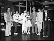 Vietnamese Refugees at Dublin Airport..1985..20.03.1985..03.20.1985..20th March 1985..After the Vietnam war,many European countries opened their doors to the dispossessed. The United Nations and several charities were to the forefront of the campaign to resettle some of the population away from the horrors of a war which had devastated large areas of Vietnam...Picture shows the Vietnamese refugees,(2nd from left),Pham Tri Thiy, Nguyen Tri Dung and Pham Thi Thao as they are met by some of their relations.