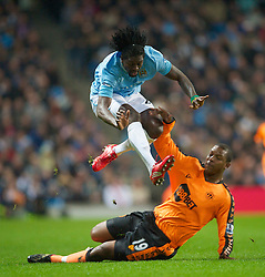 WIGAN, ENGLAND - Monday, March 29, 2010: Manchester City's Emmanuel Adebayorand Wigan Athletic's Titus Bramble during the Premiership match at the City of Manchester Stadium. (Photo by David Rawcliffe/Propaganda)