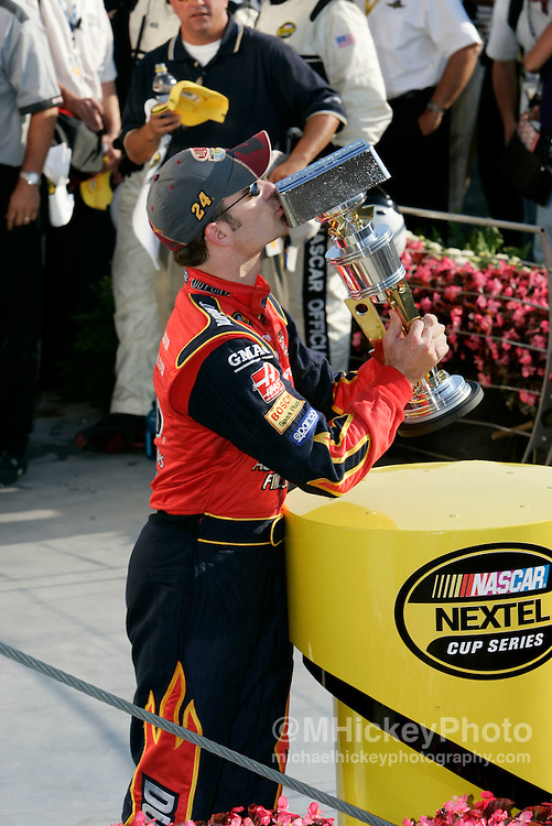 Jeff Gordon kisses his trophy after winning the Brickyard 400