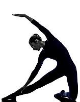 woman exercising parighasana gate pose yoga silhouette shadow white background