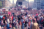 Crowd of Ravers protesting in Trafalgar Square at the First Criminal Justice March. Trafalgar Square,London,UK. 1st of May 1994.
