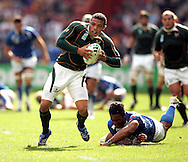 Paris, FRANCE - 9th September 2007, Bryan Habana slips another tackle during the Rugby World Cup, pool A, match between South Africa and Samoa held at Parc Des Princes Stadium in Paris, France...Photo Ron Gaunt/Sportzpics