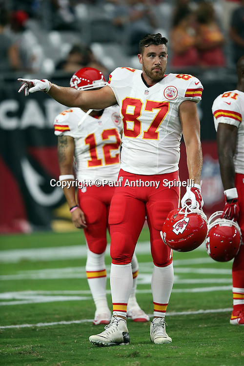 Kansas City Chiefs tight end Travis Kelce (87) points during the 2015 NFL preseason football game against the Arizona Cardinals on Saturday, Aug. 15, 2015 in Glendale, Ariz. The Chiefs won the game 34-19. (©Paul Anthony Spinelli)