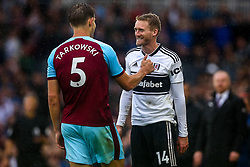 Andre Schurrle of Fulham smiles at James Tarkowski of Burnley - Mandatory by-line: Robbie Stephenson/JMP - 26/08/2018 - FOOTBALL - Craven Cottage - Fulham, England - Fulham v Burnley - Premier League
