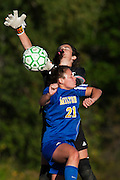 Rice goalie Hannah Miller (32) knock the ball away from Milton's Sydney Shappy (21) during the girls soccer game between the Milton Yellowjackets and the Rice Green Knights at Rice Memorial High School on Saturday afternoon October 3, 2015 in South Burlington. (BRIAN JENKINS/ for the FREE PRESS)