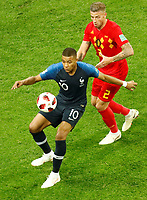 SAINT PETERSBURG, RUSSIA - JULY 10: Kylian Mbappe (L) of France national team and Toby Alderweireld of Belgium national team vie for the ball during the 2018 FIFA World Cup Russia Semi Final match between France and Belgium at Saint Petersburg Stadium on July 10, 2018 in Saint Petersburg, Russia. MB Media